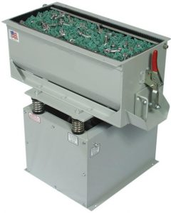 Vibratory tub, built in flow through system