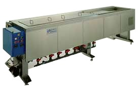 Ultrasonic cleaner system includes two counter flow rinse tanks and hot air dryer