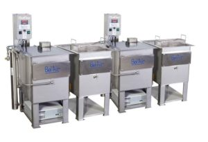 Automated cleaning system with ultrasonic cleaning and rinsing for post processing needs