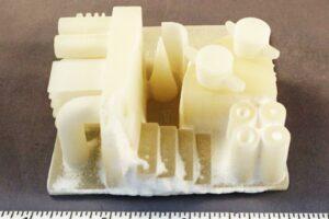 SLS printed polypropylene part before build removal